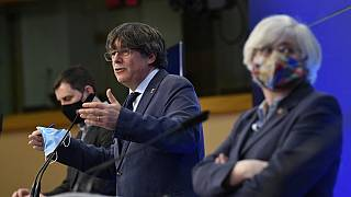 Catalan leader and MEP's Carles Puigdemont gestures as he gives a press conference at the EU parliament in Brussels