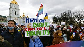 Activists shouts slogans at a rally on the occasion of the International Women's Day in Kyiv, Ukraine, Monday, March 8, 2021