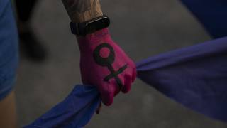 A woman participate in a march to commemorate International Women's Day