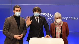Exiled former Catalan leaders and MEPs (from L) Antoni Comín, Carles Puigdemont and Clara Ponsatí give a press conference at the EU Parliament in Brussels, March 9, 2021.
