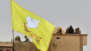 مقاتلو قوات سوريا الديمقراطية (قسد) في قرية الباغوز بمحافظة دير الزور شرقي سوريا.
