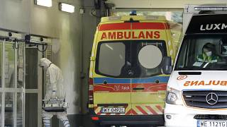 The crew of an ambulance works at a specialised COVID-19 hospital in Warsaw.