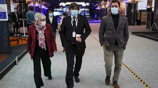 From right, MEPs Antoni Comin, Carles Puigdemont and Clara Ponsati speak with each other prior to a media conference at the European Parliament in Brussels. March 9, 2021.,