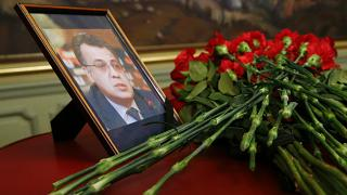 Flowers lay next to a portrait in memory of Russian Ambassador to Turkey, Andrei Karlov.