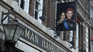 A sign showing Britain's Prince Harry and his wife Meghan, hangs outside the Duke of Sussex pub near Waterloo station, London, Tuesday March 9, 2021