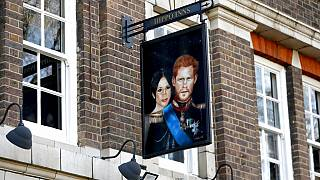 A sign depicting the image of Britain's Prince Harry and his wife Meghan, hangs outside the Duke of Sussex pub near Waterloo station, London, Tuesday March 9,