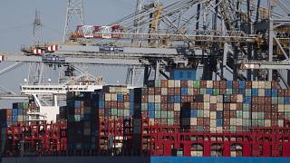 Shipping containers are offloaded in Antwerp, March 2020. Belgian prosecutors say a huge police operation against organised crime took place across Belgium on March 9, 2021.