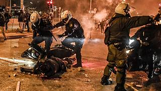 Motorised police arrive to tend to their injured colleague during a demonstration against police violence in an Athens suburb on March 9, 2021.