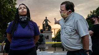 Anais (26) argues for the removal of the Emancipation Memorial with a man (right) who wishes to keep it, in Lincoln Park, Washington DC, USA. June 25, 2021