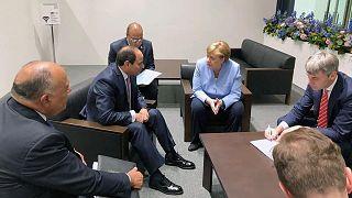 صورة من الارشيف- لقاء الرئيس المصري عبد الفتاح السيسي  مع المستشارة الألمانية أنجيلا ميركل على هامش قمة مجموعة العشرين في أوساكا باليابان، مع المخابرات الخارجية المصرية