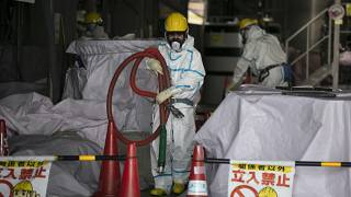 Archive image of a worker at a water treatment facility at the Fukushima nuclear power plant, Japan