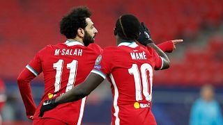 Liverpool, PSG reach Champions League quarters