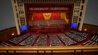 Leaders and delegates attend the closing session of Chinese People's Political Consultative Conference (CPPCC) at the Great Hall of the People in Beijing