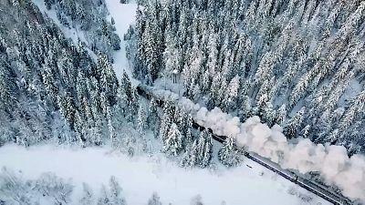 A traditional steam train chugs its way through Karelia, Russia.