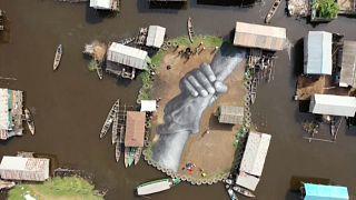 Giant fresco appears in floating Benin village