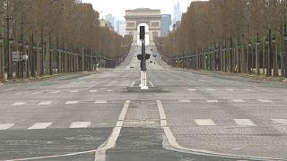 Deserted Avenue des Champs-Elysées with the Arc de Triomphe in the background - Paris, March 29, 2020