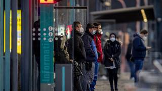 People wearing face masks wait for a train at a subway station in Frankfurt, Germany, Friday, March 12, 2021, as the number of Corona infections in Germany rises again.