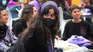 Women take part in a demonstration marking the International Women's Day in Seville