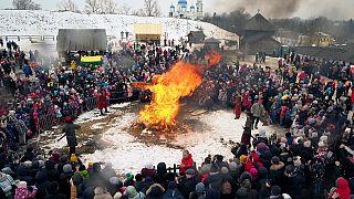 People watch as an effigy of Lady Maslenitsa burns during celebrations of Maslenitsa