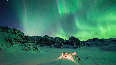 Aurora borealis over Sheldon Chalet, Denali National Park, Alaska, USA