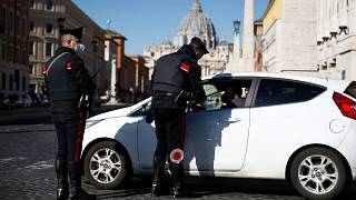 Carabinieri police officers stop a car in Rome, after the region was locked down once again