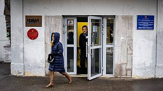 A security guard stands at the door of the building of the editorial office of Novaya Gazeta newspaper in Moscow on March 15, 2021.