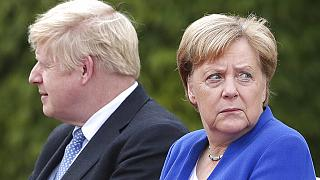 German Chancellor Angela Merkel welcomes Britain's Prime Minister Boris Johnson for a meeting at the Chancellery in Berlin, Germany, Wednesday, Aug. 21, 2019
