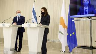 Israeli Energy Minister Yuval Steinitz, Cyprus Energy Minister Natasa Pilides, and Greece's Environment & Energy Minister Kostas Skrekas during a press conference in Nicosia.