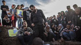 File: people attend the funeral of a Syrian Democratic Forces fighter, killed in a battle with remnants of the Islamic State group in eastern Syria. March 10, 2020.