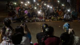 Anti-coup protestors flash lights from their mobile phones during a rally in the Myaynigone area of Yangon.