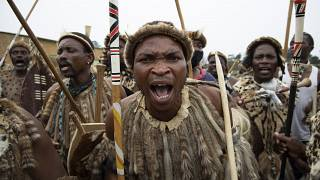 S. Africa's Zulu mourners accompany their late King with dance