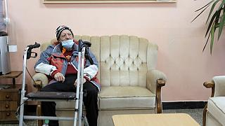An elderly man waits to receive a dose of the COVID-19 vaccine, at Nadezhda nursing home, in Sofia, Wednesday, Jan. 27, 2021