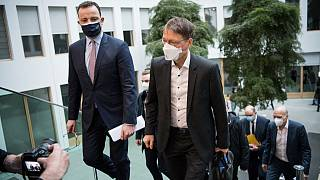 German Health Minister Jens Spahn (L) arrives for a news conference on March 19, 2021 in Berlin, amid the novel coronavirus / COVID-19 pandemic.