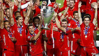 Munich players lift the trophy after Munich won the Champions League final soccer match between Paris Saint-Germain and Bayern Munich at the Luz stadium in Lisbon,