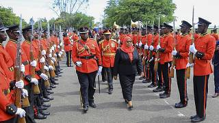 Tanzania's new president Samia Suluhu Hassan inspects the guard of honor