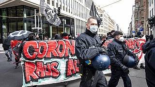 "Various initiatives and left-wing groups demonstrate against a demo of right-wing extremists and so-called ""Reichsbuerger"" in Berlin, Germany, Saturday, March 20, 2021."