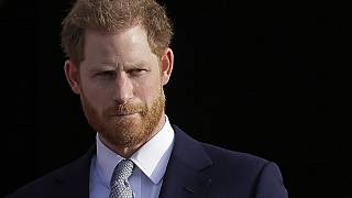 In this Thursday, Jan. 16, 2020,file photo, Britain's Prince Harry arrives in the gardens of Buckingham Palace in London.
