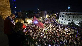 Thousands of protesters chant slogans and hold signs during a protest against Israel's Prime Minister Benjamin Netanyahu outside his residence in Jerusalem, Saturday, March. 2
