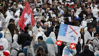 Protesters take part in a demonstration against the ongoing coronavirus Covid-19 restrictions in Liestal, near Basel, Switzerland, on March 20, 2021.