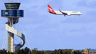FILE: A Qantas jet prepares to land at Sydney Airport in Sydney, Oct. 31, 2011.