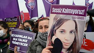 A protester holds a picture of a woman killed by a man at a demonstration against Turkey's withdrawal from the Istanbul Convention,  in Istanbul, on March 20, 2021.