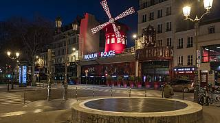 Empty streets in front of the Moulin Rouge as the 7 p.m curfew starts in Paris, France, on Saturday, March 20, 2021.
