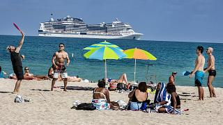 Beach goers enjoy the beautiful weather at the beach, Wednesday, March 2, 2021 in Miami Beach
