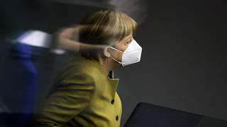 FILE: Chancellor Angela Merkel attends a debate of the German Parliament Bundestag about the coronavirus outbreak situation in Berlin, Germany, Thursday, March 4, 2021.