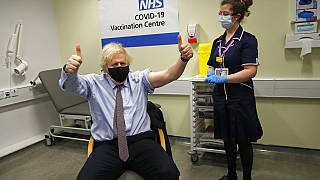 FILE - Britain's Prime Minister Boris Johnson gestures after receiving the first dose of the AstraZeneca vaccine in London, Friday, March 19, 2021.