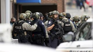 Police stand outside King Soopers grocery store after a mass shooting, Monday, March 22, 2021, Boulder, Colorado, United States