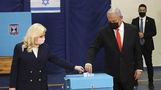 Israeli Prime Minister Benjamin Netanyahu and his wife Sara cast their ballots at a polling station as Israelis vote in a general election, in Jerusalem. March 23, 2021