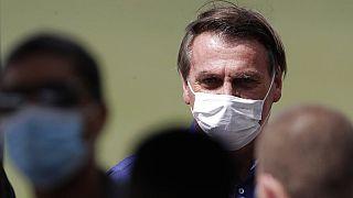 Brazil's President Jair Bolsonaro celebrates his 66th birthday with supporters at the Alvorada Palace