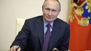 Russian President Vladimir Putin listens during a meeting with government officials via video conference at the Novo-Ogaryovo residence outside Moscow, Russia.