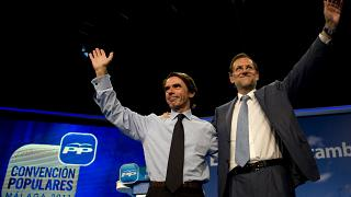 FILE:  Mariano Rajoy, then leader of the Spanish opposition party Partido Popular (PP), waves to supporters next to former PM Jose Maria Aznar, October 6, 2011